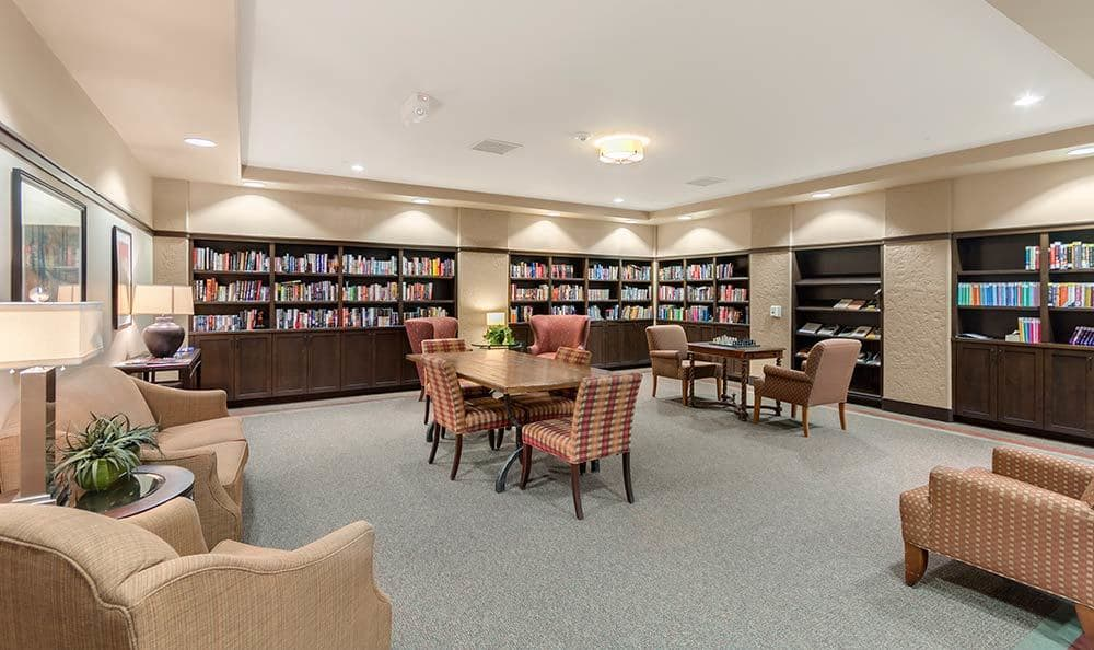 Read your favorite book at Merrill Gardens at Green Valley Ranch's library