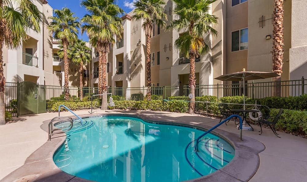 Take a dip at the pool at Merrill Gardens at Green Valley Ranch