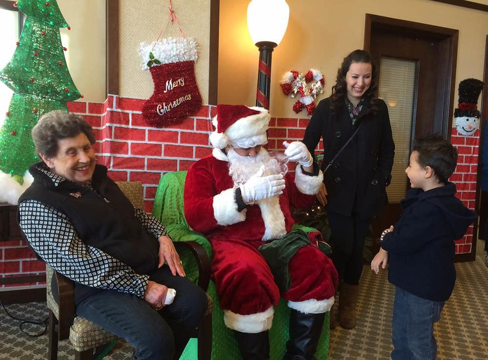 Santa and Residents at Merrill Gardens at Kirkland in Kirkland