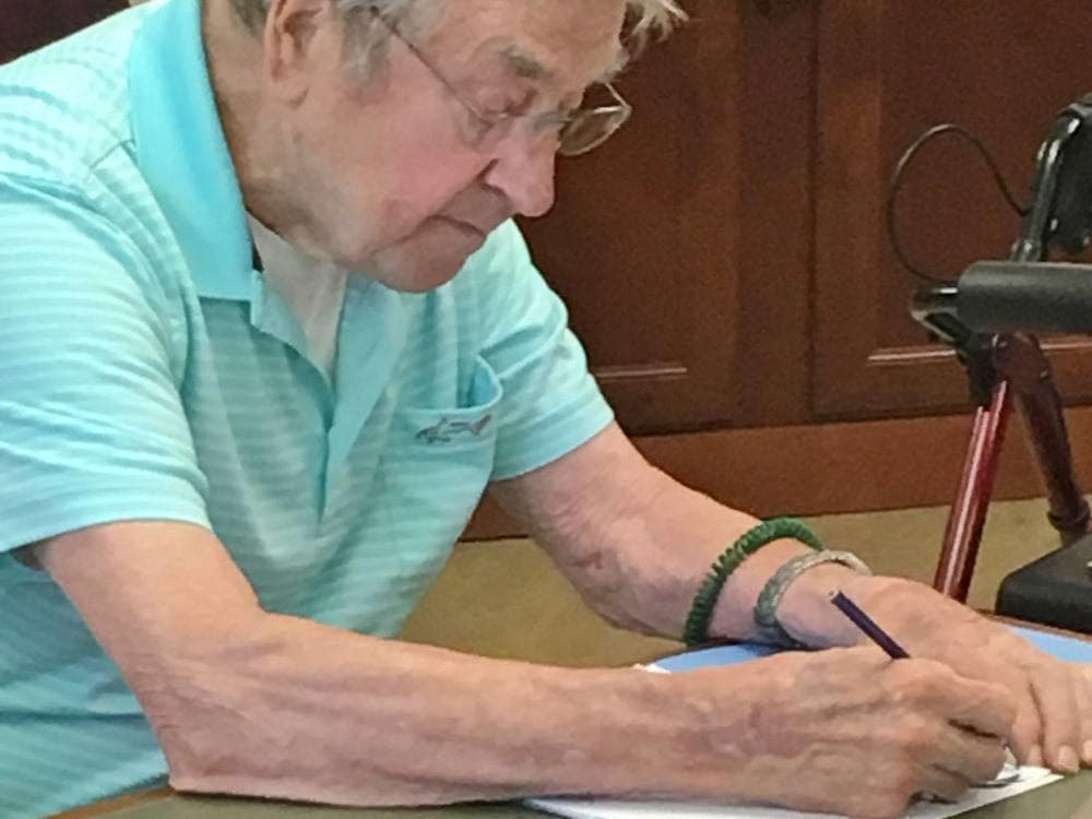 Resident enjoying drawing at Merrill Gardens at The University
