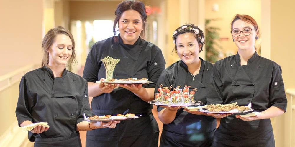Servers exposing their food at Merrill Gardens at Rolling Hills Estates in Rolling Hills Estates, California
