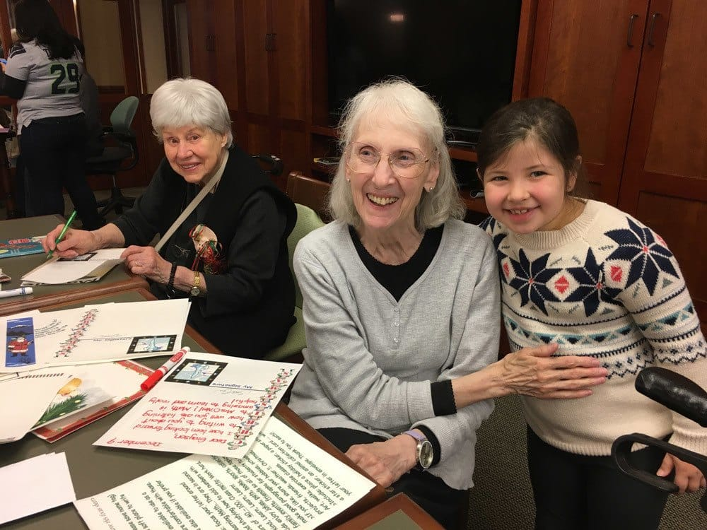 Resident and Child enjoy time together at Merrill Gardens at The University in Seattle