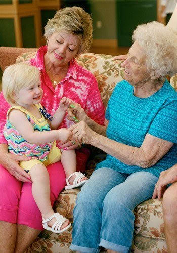 Senior citizen enjoying a moment with her granddaughter at Merrill Gardens at Columbia in Columbia, South Carolina