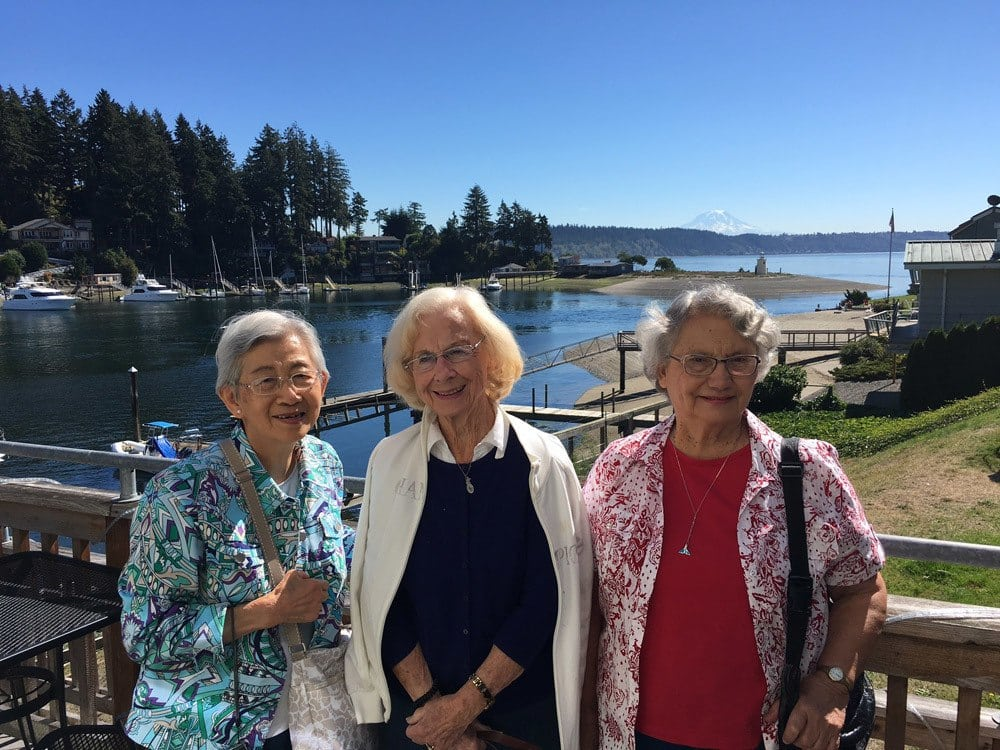 Three friends from Merrill Gardens at The University in Seattle