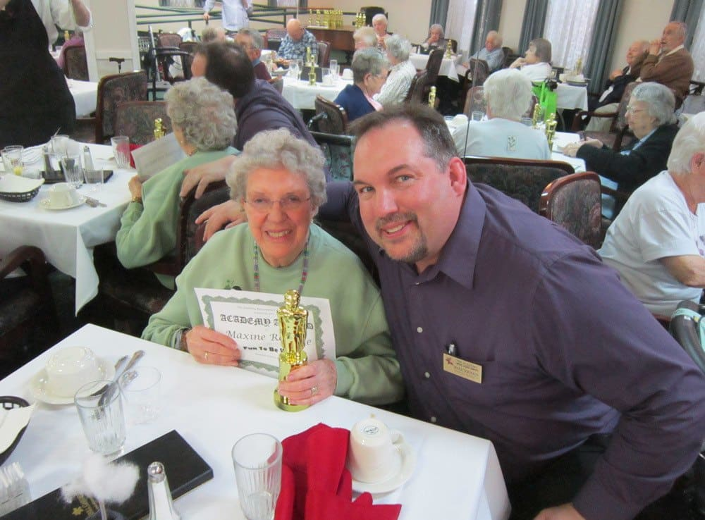 Resident Receiving Award at The Academy, A Merrill Gardens Community