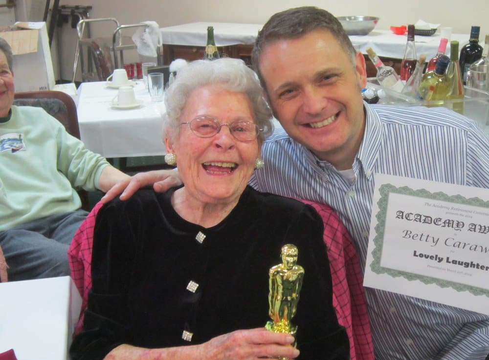 Senior-Living Resident Receiving Award at The Academy, A Merrill Gardens Community