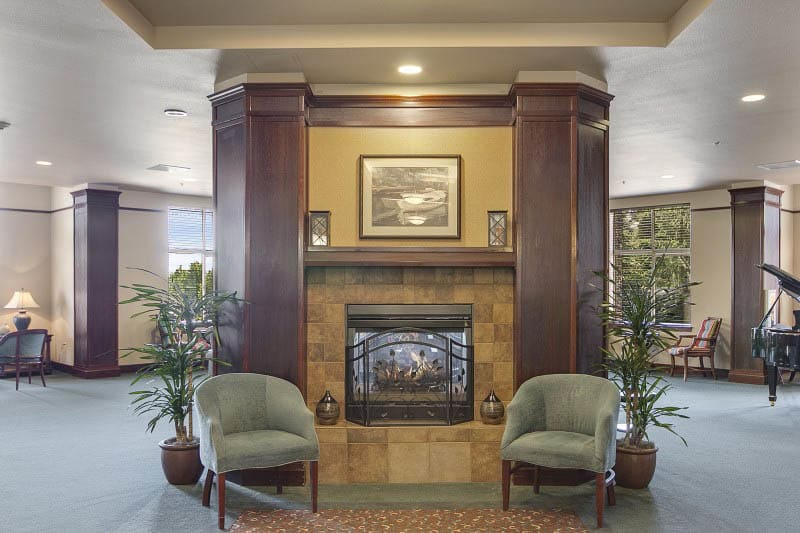 Indoor fireplace at senior living in Tacoma, WA