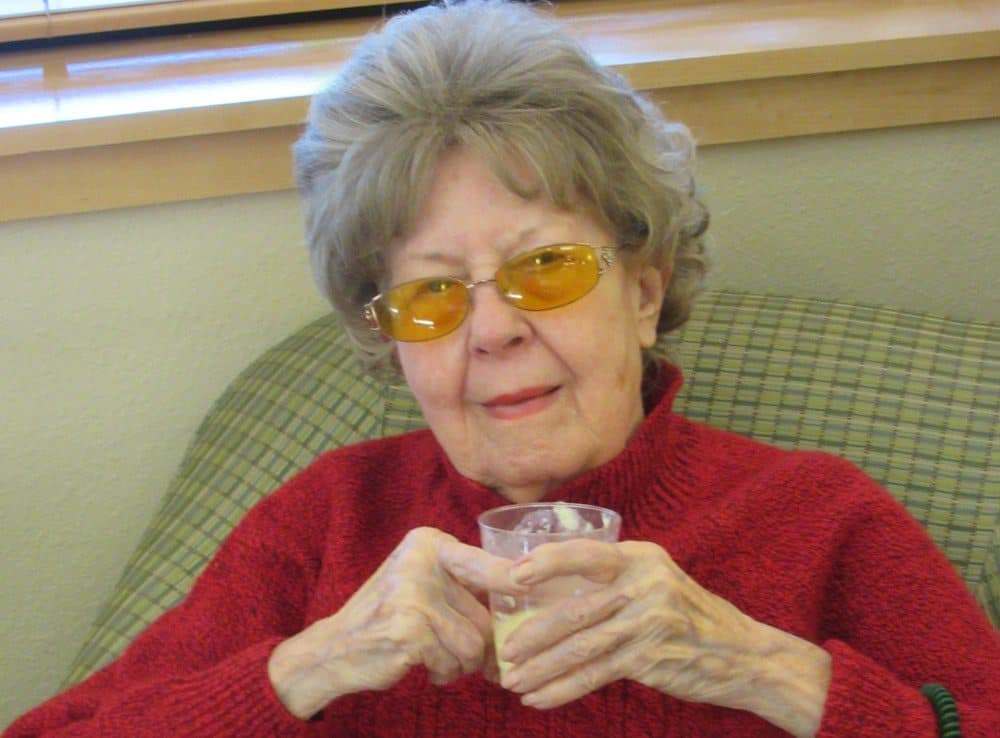 Resident at Merrill Gardens at Bankers Hill enjoys beverage