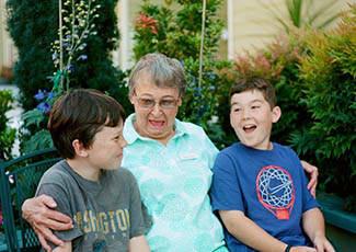Resident with her grandchildren at Campbell senior living