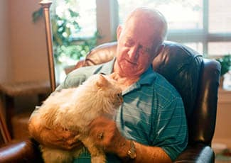 Resident with his pet at senior living in Campbell