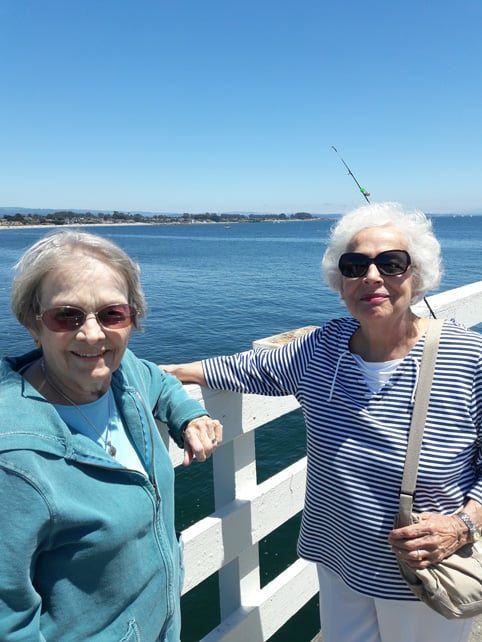 Residents at Merrill Gardens at Campbell spending time together at the board walk