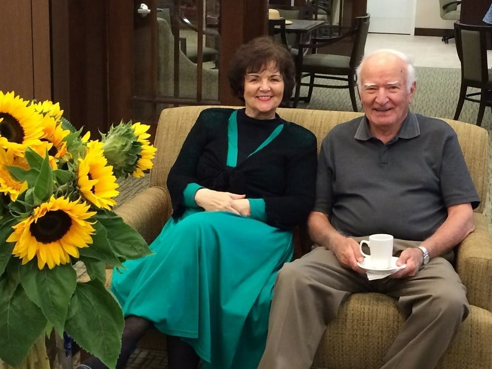 Couple enjoying the common areas at Merrill Gardens at Lafayette