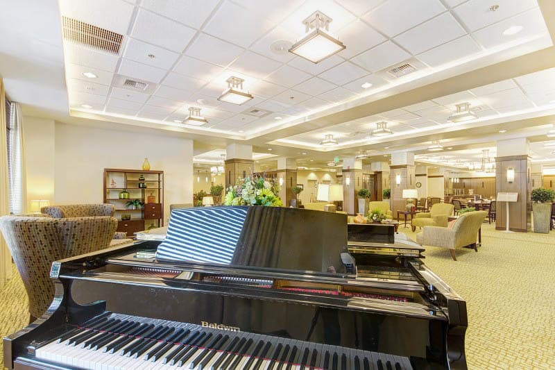 Lobby with piano at Merrill Gardens at Lafayette in Lafayette, California.