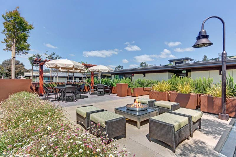 Rooftop seating with fire pit at Lafayette senior living