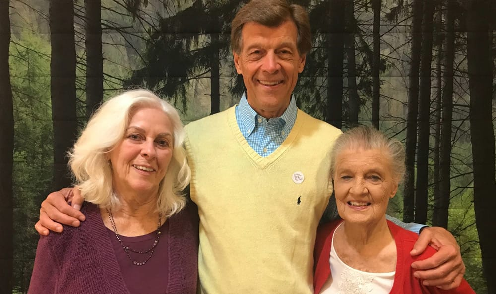 Resident and family members spending time together at Merrill Gardens at First Hill