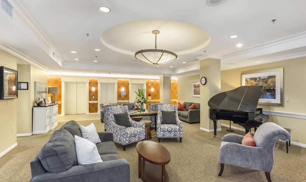 Beautiful and bright living area with piano at Merrill Gardens at First Hill