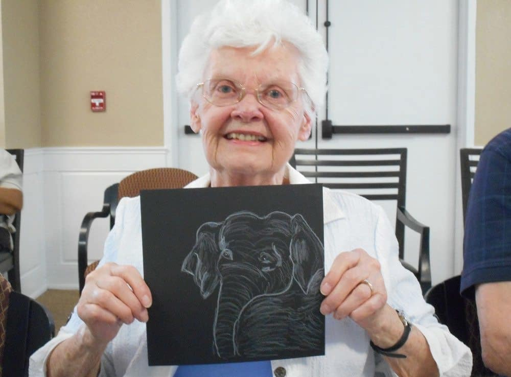 Residents enjoying art activities at Merrill Gardens at Gilroy in Gilroy