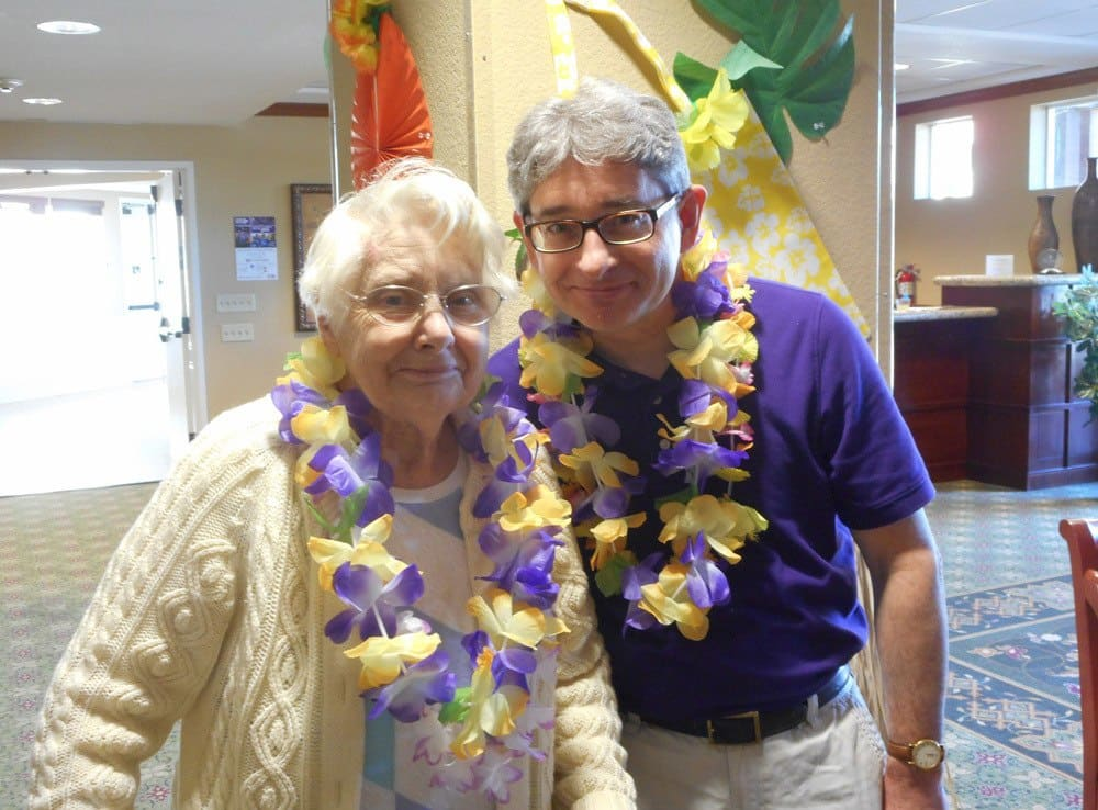 Residents enjoying Hawaiian Day at Merrill Gardens at Gilroy in Gilroy