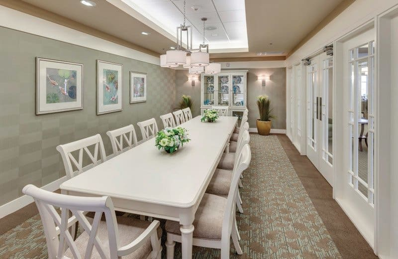 Private dining room at Merrill Gardens at Huntington Beach in Huntington Beach, California.