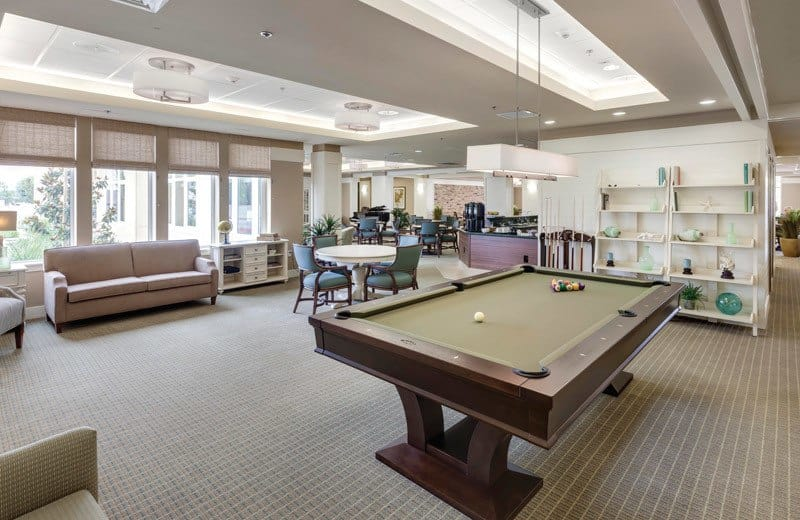 The game room at Merrill Gardens at Huntington Beach in Huntington Beach, California.