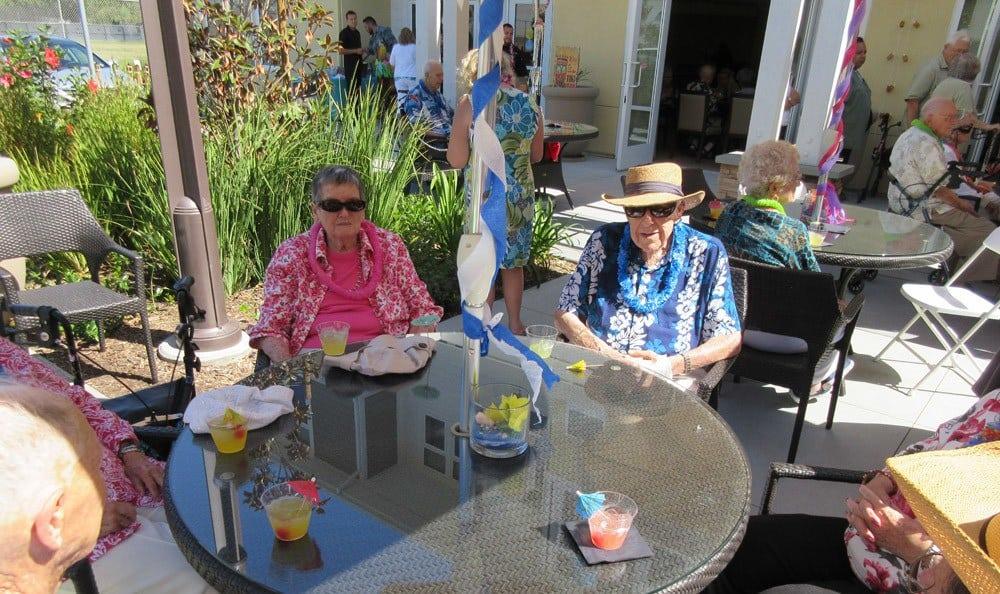 Residents enjoying the patio at Merrill Gardens at Huntington Beach in Huntington Beach, California.