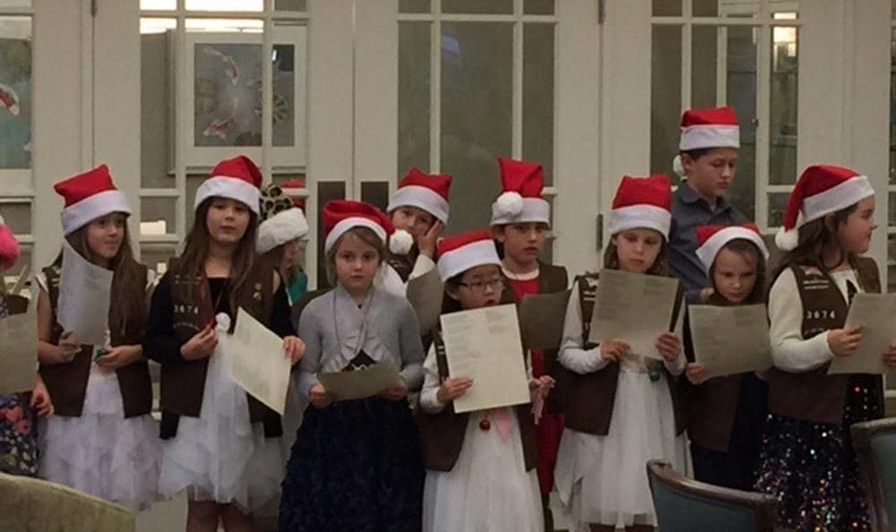 Children Singing for the Holidays at Merrill Gardens at Huntington Beach in Huntington Beach, CA