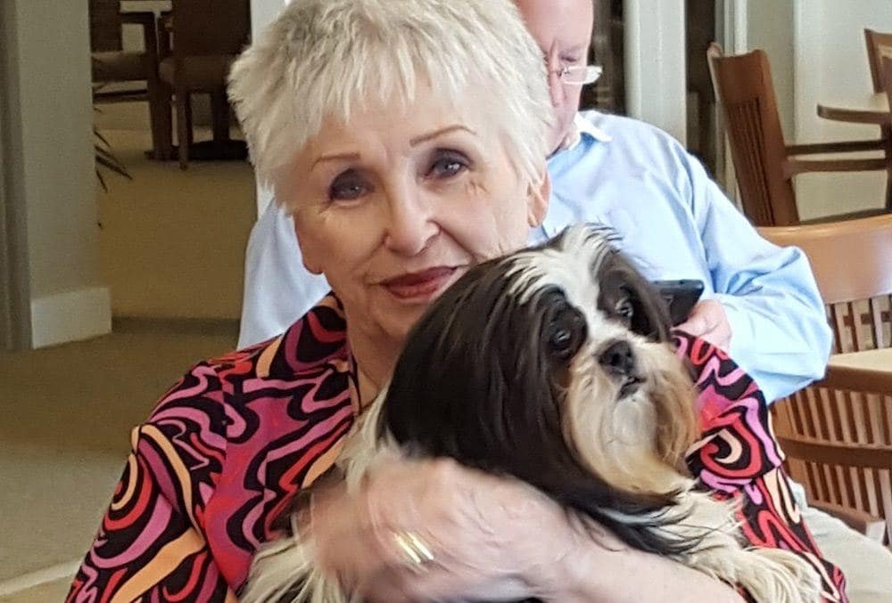 Resident loving her pet at our senior living community in Madison, AL