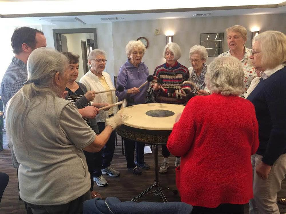 Residents Beating a Drum at The Patrician, A Merrill Gardens Community in San Diego