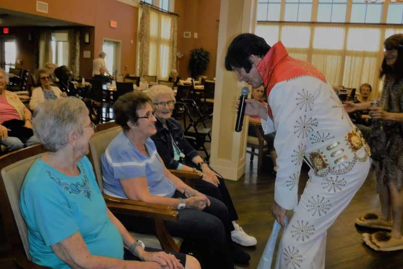 Residents laughing with Elvis at The Groves in AZ
