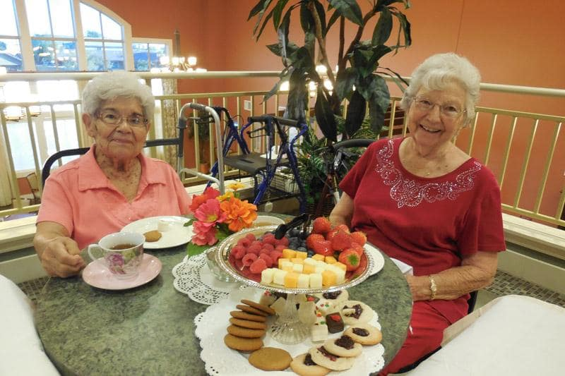 Friends Enjoying Holidays at The Groves, A Merrill Gardens Community in Goodyear