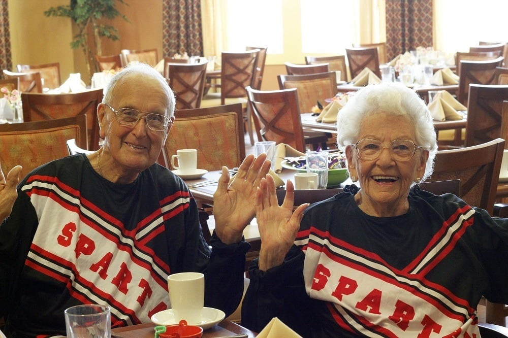 Residents in their cheer-leading uniforms