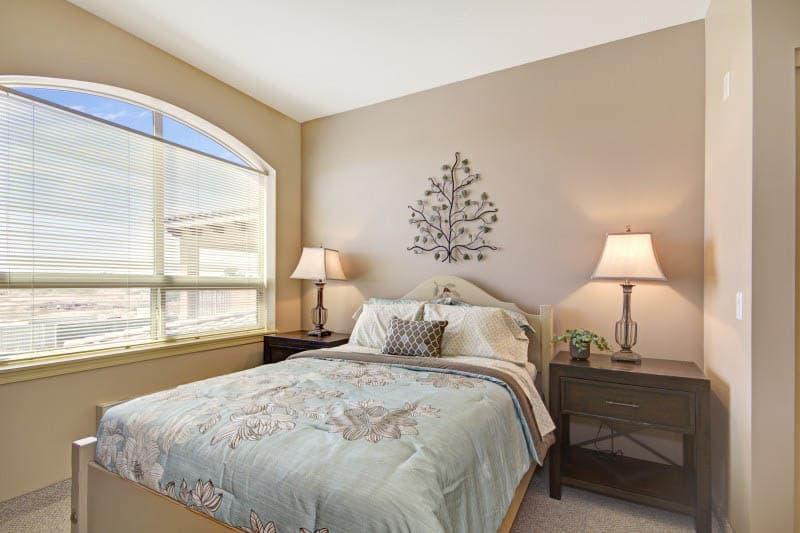 Bedroom at The Oaks, A Merrill Gardens Community senior living