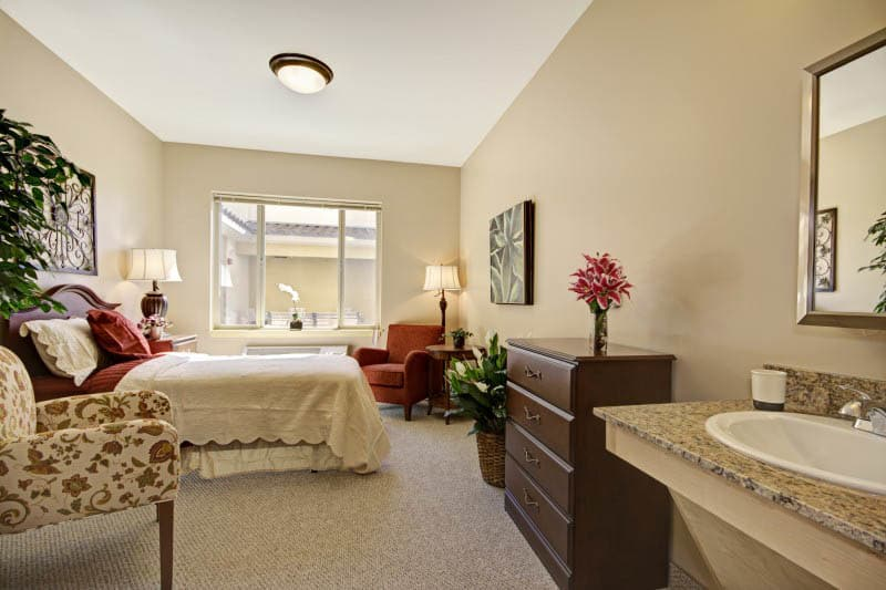 Spacious bedroom at The Oaks, A Merrill Gardens Community in Gilbert, AZ