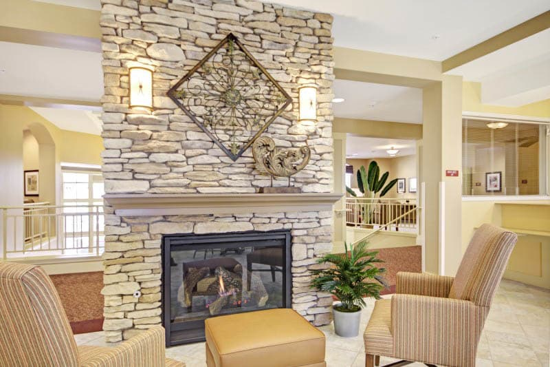 Fireplace at The Oaks, A Merrill Gardens Community senior living
