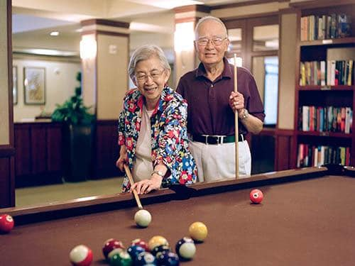 Seniors living a happy life here at The Pines, A Merrill Gardens Community