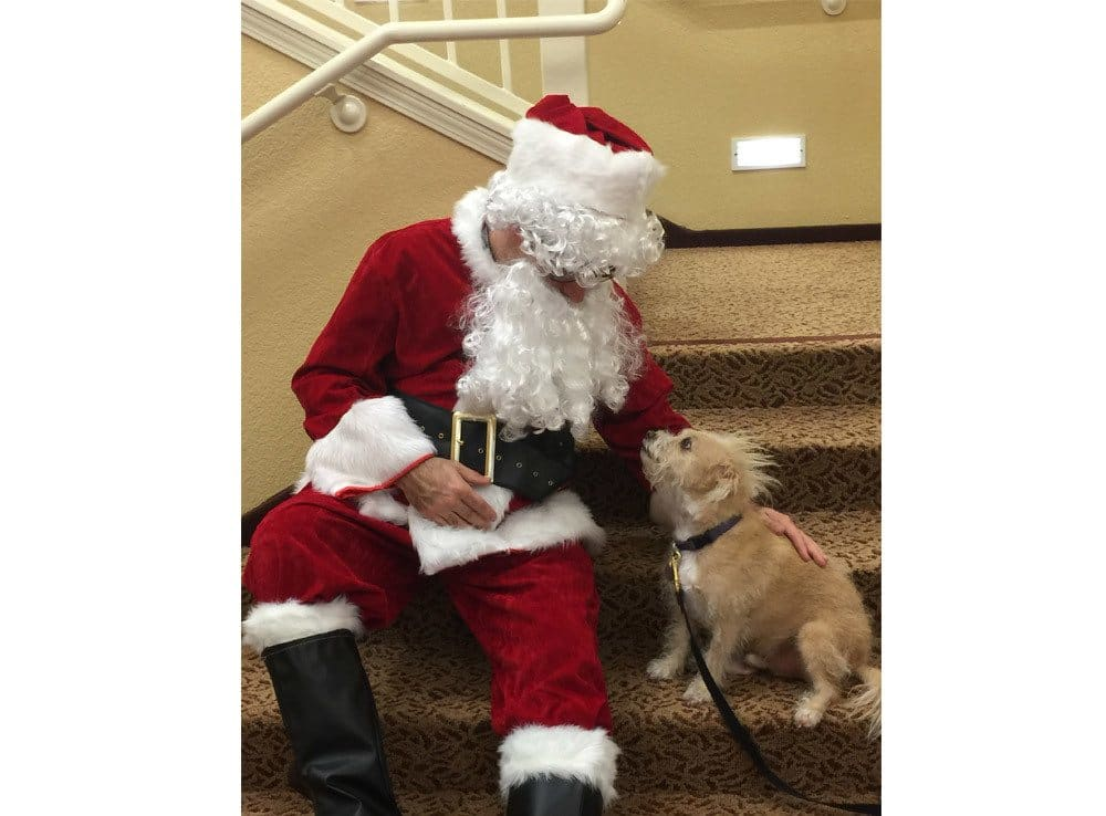 Santa and a Residents Dog at The Pines, A Merrill Gardens Community