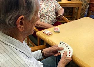 Card game at senior living in Woodstock