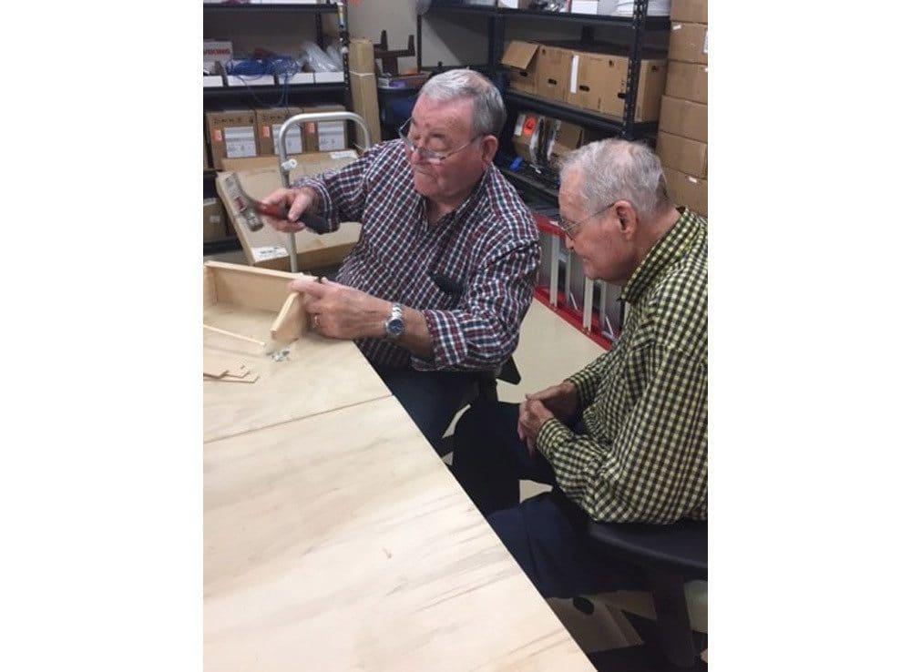 Woodworking with Residents at Merrill Gardens at Woodstock