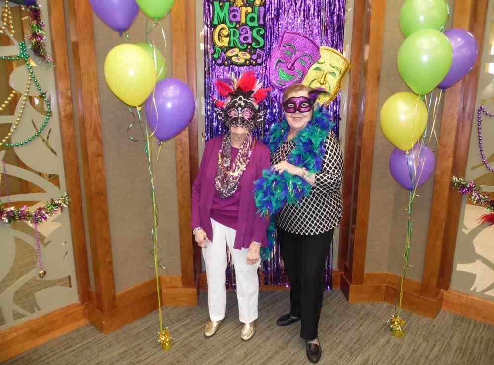 Residents having fun at the Mardi Gras Party