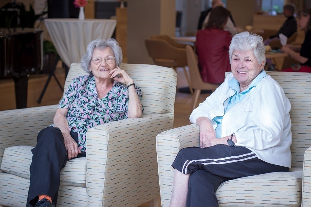 Two ladies chatting at our senior living community in Ballard, WA