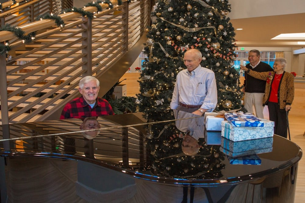 Residents Playing the piano at Merrill Gardens at Ballard in Seattle, Washington