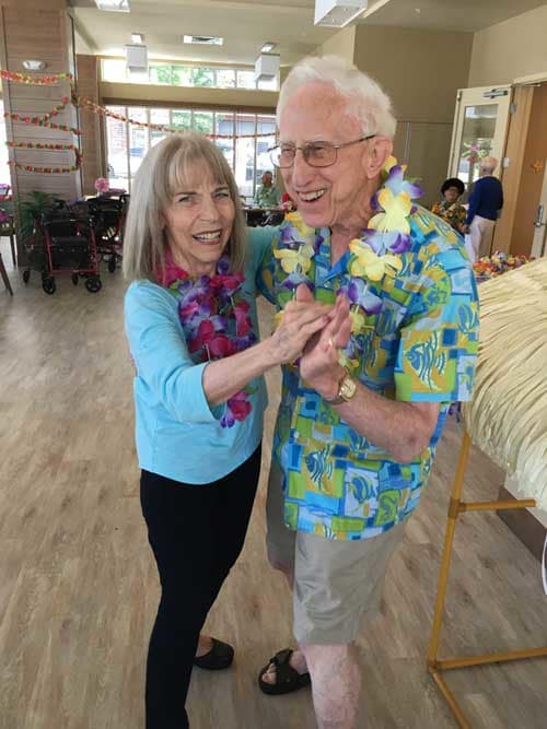 Dancing with friends at Merrill Gardens at Burien
