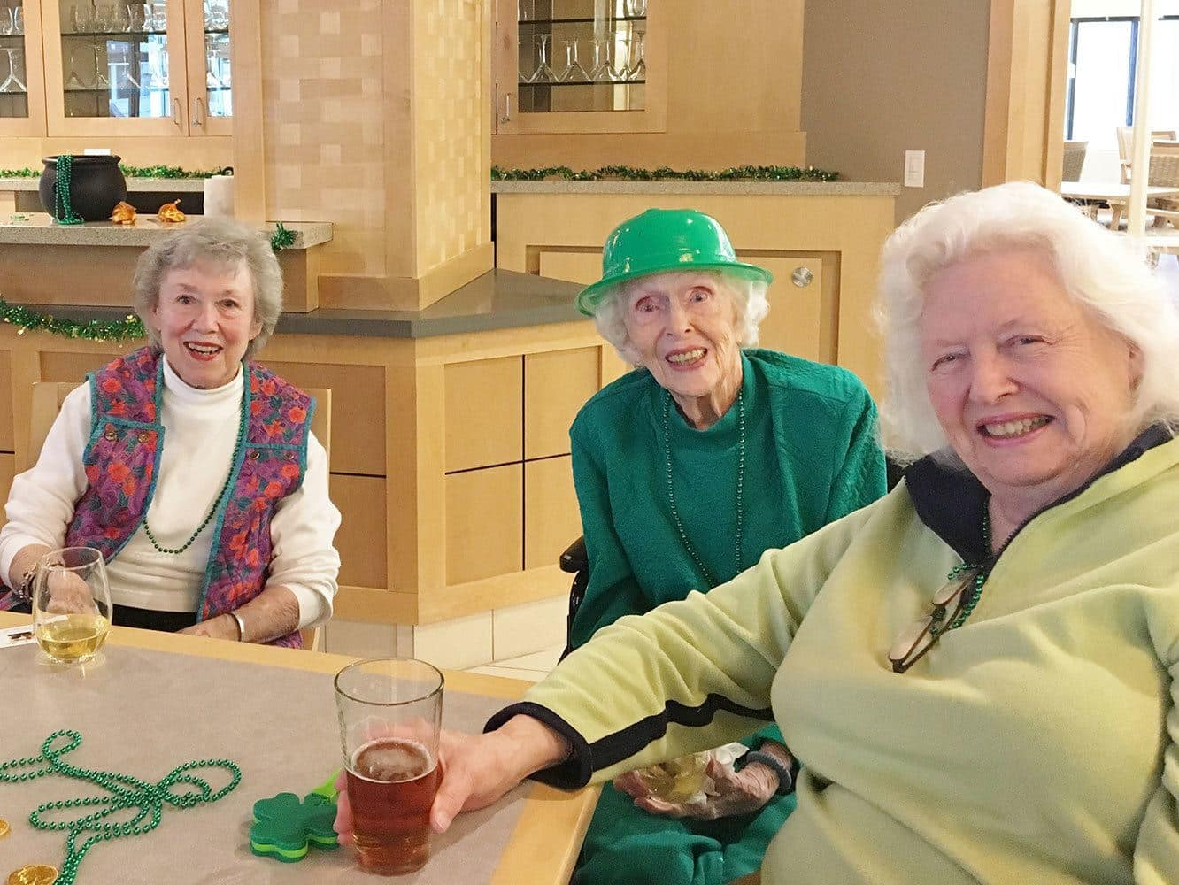 Ladies smiling at a holiday gathering