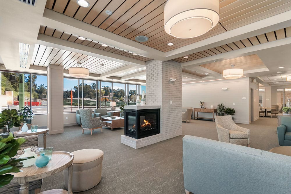 Fireplace lounge at Merrill Gardens at Rockridge in Oakland, California.