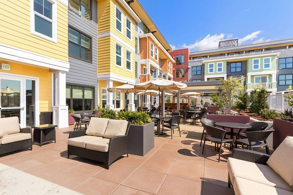 Outdoor Patio and Dining area at Merrill Gardens at Rockridge in Oakland, California.