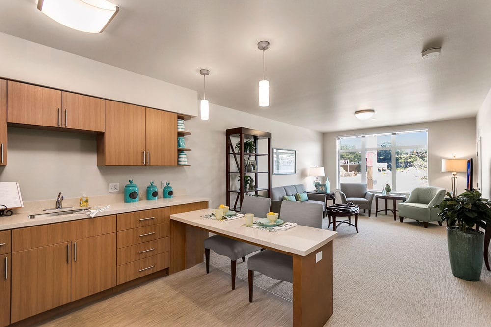 Resident kitchen and dining area at Merrill Gardens at Rockridge in Oakland, California.