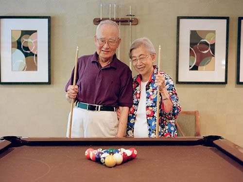 Seniors playing billiards at Merrill Gardens at Rolling Hills Estates in Rolling Hills Estates, California