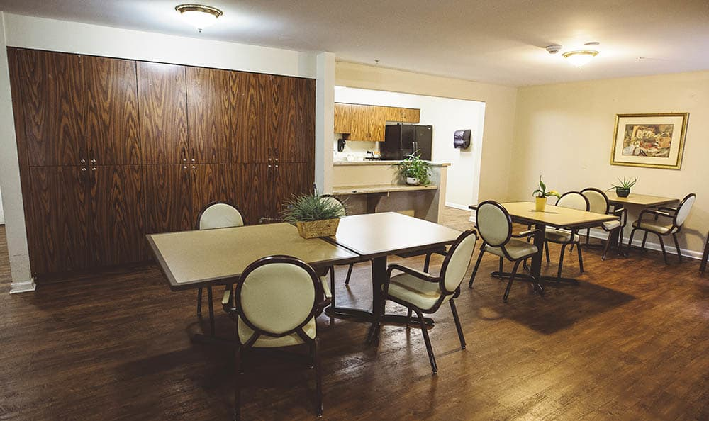 alternate community kitchen with hardwood flooring