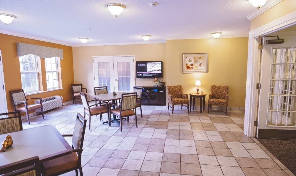Gorgeous living room with a fireplace at Broadview Assisted Living at Tallahassee
