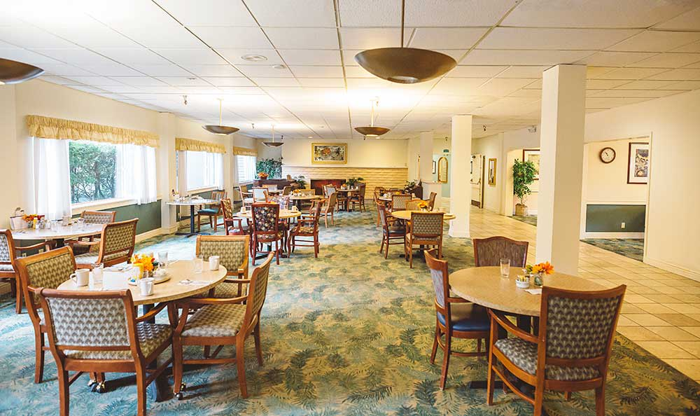Gather with your friends for a meal at the dining room at The Village Senior Living
